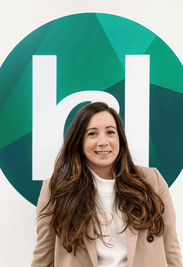 Daniella in front of Katy Dwyer Design Logo
