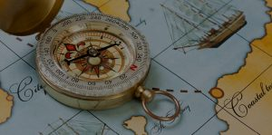 Photo of a compass and a map