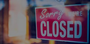 "Picture of a ""Sorry, We're Closed"" Sign"