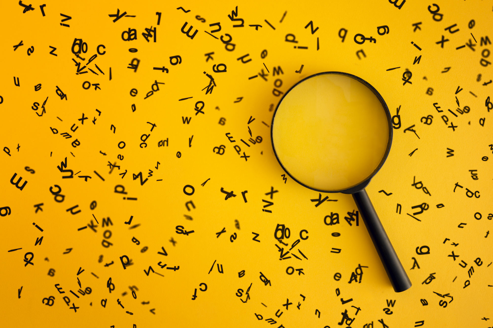 magnifying glass and letters